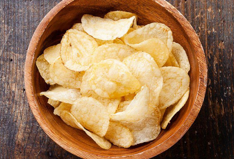 """<p>It's the high salt content that make chips so intensely satisfying to your taste buds. """"But they're addictive to many since craving salt can be a sign of adrenal fatigue and the need for electrolytes,"""" explains Jackie Arnett Elnahar RD, Esq. """"The high proportion of fat to calories in chips is also highly satisfying since the calories are rich and feel instantly gratifying."""" Not to mention that chips are an easy and convenient snack to grab and go—adding to its addictive quality. Eat This Instead: A good alternative would be to start buying chips made with veggies and superfoods. </p>"""