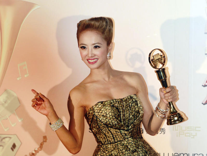 Taiwanese singer Jolin Tsai holds her award for the Song of the Year at the 24th Golden Melody Awards in Taipei, Taiwan, Saturday, July 6, 2013. The Golden Melody Awards is one of the Chinese-language pop music world's biggest annual events. (AP Photo/Wally Santana)