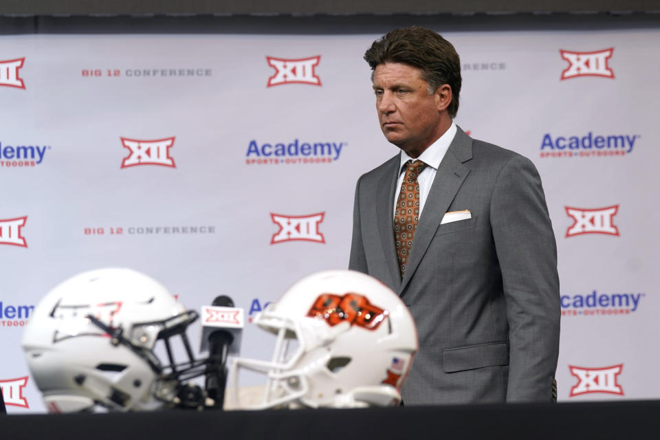 Oklahoma State head coach Mike Gundy walks onto the stage to speak during the NCAA college football Big 12 media days Thursday, July 15, 2021, in Arlington, Texas. (AP Photo/LM Otero)