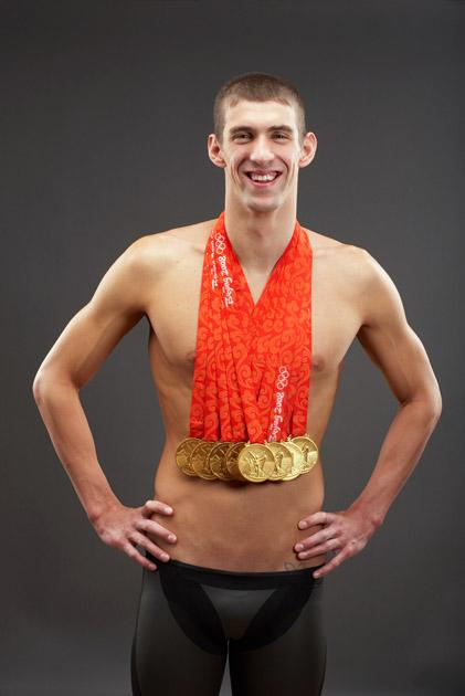 Swimmer Michael Phelps of the United States poses with his eight gold medals all won in competition during the Beijing 2008 Olympic Games on August 18, 2008 in Beijing, China.  (Photo by Al Bello/Getty Images) *** Local Caption *** Michael Phelps
