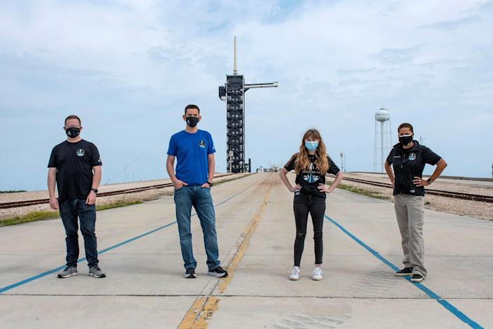 Jared Isaacman, Hayley Arceneaux, Sian Proctor and Chris Sembroski pose for a photo at NASA's Kennedy Space Center at Cape Canaveral, Florida, on March 29.