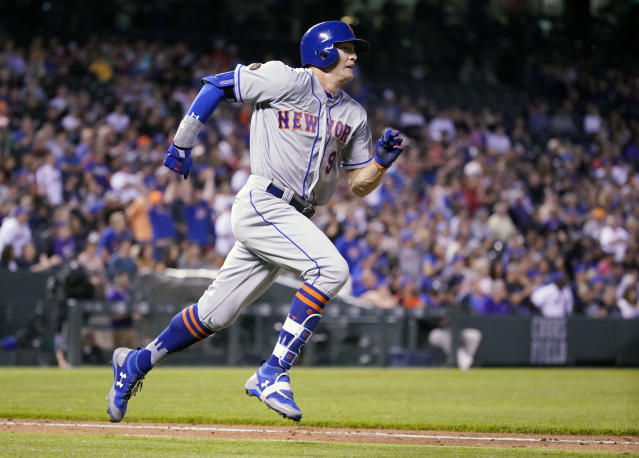 Brandon Nimmo sprinted around the bases to lead off Monday against the Rockies with an inside-the-park home run before hitting a 449-foot blast later in the game. (AP)