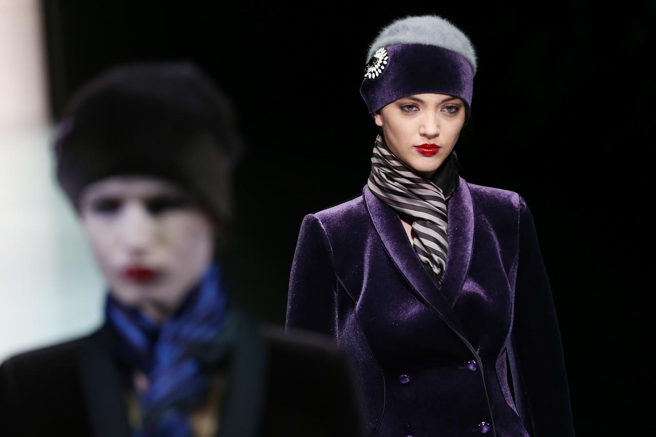 MILAN, ITALY - FEBRUARY 24:  A model walks the runway at the Emporio Armani fashion show as part of Milan Fashion Week Womenswear Fall/Winter 2013/14 on February 24, 2014 in Milan, Italy.  (Photo by Vittorio Zunino Celotto/Getty Images)