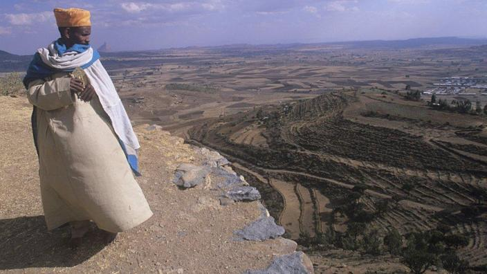 Aksum, monk overlooking Monastery of Abba Pantelewon, founded in 6th century