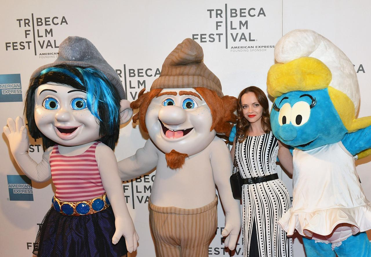 "NEW YORK, NY - APRIL 27:  Actress Christina Ricci (C) and the Smurf characters (L-R) Vexy, Grouchy and Smurfette attend the ""The Smurfs"" Family Festival Screening during the 2013 Tribeca Film Festival on April 27, 2013 in New York City.  (Photo by Slaven Vlasic/Getty Images)"