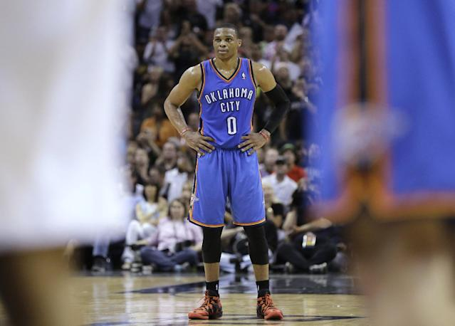 Oklahoma City Thunder's Russell Westbrook (0) watches as teammate Kevin Durant shoots a free throw during the second half of Game 5 of the Western Conference finals NBA basketball playoff series against the San Antonio Spurs, Thursday, May 29, 2014, in San Antonio. (AP Photo/Eric Gay)