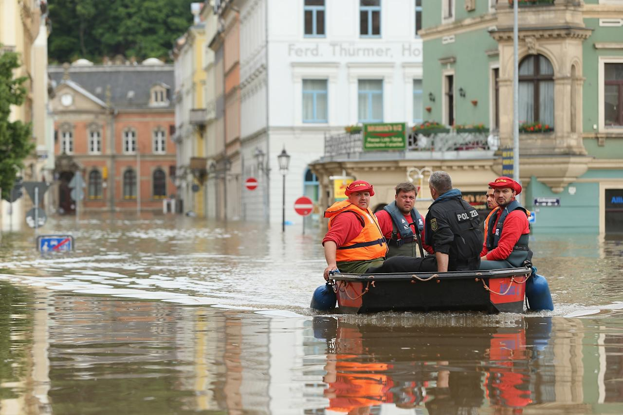 MEISSEN, GERMANY - JUNE 06: Rescue workers in a rubber boat pass through streets flooded by the nearby Elbe river in the historic city center on June 6, 2013 in Meissen, Germany. Eastern and southern Germany are suffering under floods that in some cases are the worst in 400 years. At least four people are dead and tens of thousands have evacuated their homes. (Photo by Sean Gallup/Getty Images)
