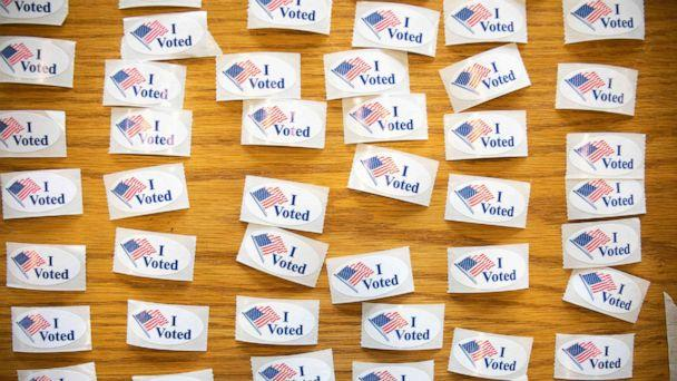 PHOTO: 'I Voted' stickers cover a table at a polling station during the North Carolina primary on Super Tuesday in Charlotte, N.C. on March 3, 2020. (Logan Cyrus/AFP via Getty Images)
