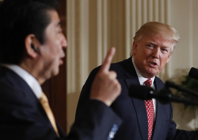 <p> President Donald Trump listens Japanese Prime Minister Shinzo Abe speaks during a joint new conference in the East Room of the White House, in Washington, Friday, Feb. 10, 2017. (AP Photo/Carolyn Kaster) </p>
