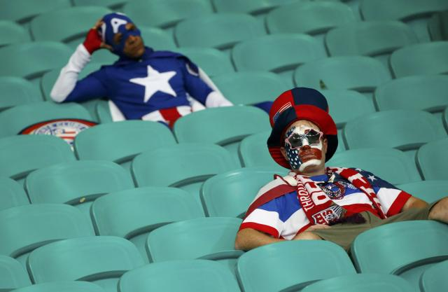 U.S. fans show dejection at the end of the extra time of the 2014 World Cup round of 16 game between U.S. and Belgium at the Fonte Nova arena in Salvador July 1, 2014. REUTERS/Sergio Moraes (BRAZIL - Tags: SOCCER SPORT WORLD CUP TPX IMAGES OF THE DAY) TOPCUP