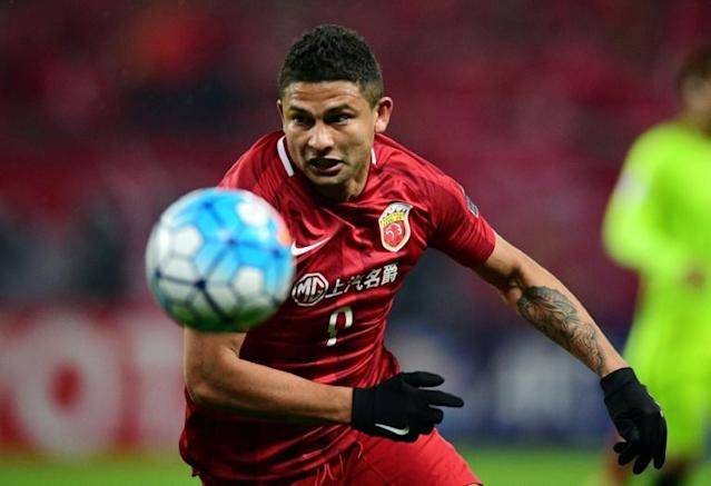 Brazil-born Elkeson has become the first footballer without Chinese heritage to be picked for a national squad. (AFP Photo/Johannes EISELE)