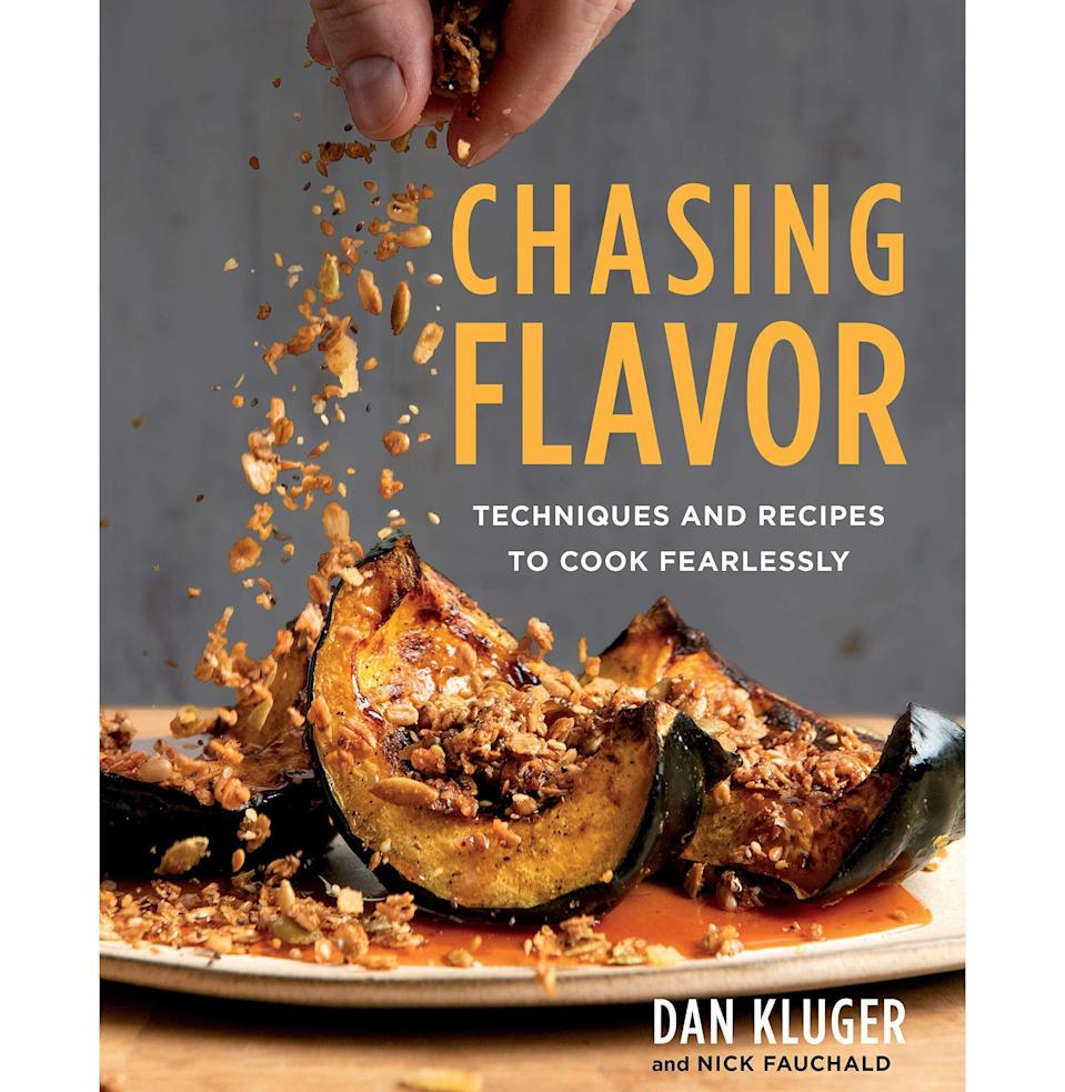 """<p><strong>By Dan Kluger with Nick Fauchald (Photographs by Evan Sung)</strong></p><p>bookshop.org</p><p><strong>$32.20</strong></p><p><a href=""""https://go.redirectingat.com?id=74968X1596630&url=https%3A%2F%2Fbookshop.org%2Fbooks%2Fchasing-flavor-techniques-and-recipes-to-cook-fearlessly%2F9781328546333&sref=https%3A%2F%2Fwww.esquire.com%2Ffood-drink%2Ffood%2Fg31206127%2Fbest-cookbooks-2020%2F"""" rel=""""nofollow noopener"""" target=""""_blank"""" data-ylk=""""slk:Buy"""" class=""""link rapid-noclick-resp"""">Buy</a></p><p>Dan Kluger's regular-guy persona undercuts the recognition he deserves for being an innovator. No, he doesn't preen and proclaim like some """"gastronomic pioneer,"""" but his modest wizardry with vegetables—at New York's ABC Kitchen, originally, and more recently at Loring Place—has made him an important influence on American chefs and home cooks alike. Spending time with <em>Chasing Flavor</em> is like flipping through an encyclopedia of deliciousness. Roasted delicata squash with hazelnuts, spicy onions, and goat cheese? Zucchini pizza with soppressata and tomato jam? Brussels sprouts with mustard vinaigrette? Crushed cucumbers with yogurt and chiles? We want to eat this way every night. <em>—J.G.</em></p>"""
