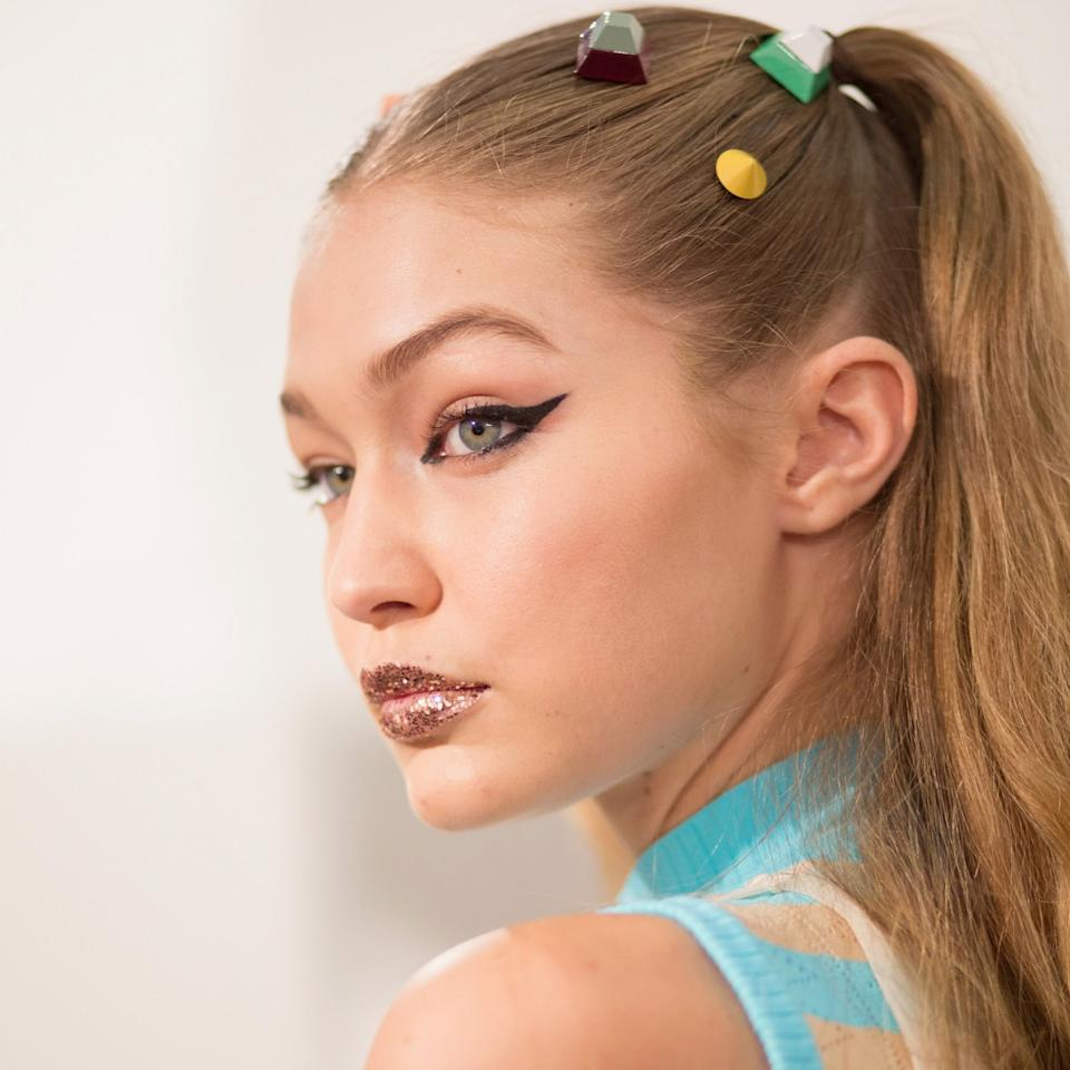"<p>Makeup artist Peter Philips broke out of the golden eye handcuffs, instead dabbing the model's lips at Fendi's spring 2017 show with a mesmerizing salmon-pink loose glitter. Blotting works to your benefit, <a rel=""nofollow"" href=""http://www.allure.com/story/fendi-beauty-spring-summer-16?mbid=synd_yahoobeauty"">he told <em>Allure</em></a>; flattened, the sparkle looks less disco-ball and more like liquid metal reflecting light.</p>"
