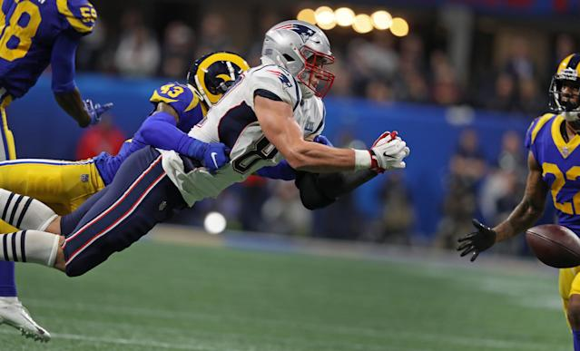 <p>Rob Gronkowski dives but can't make the catch on a pass from quarterback Tom Brady (not pictured). The Rams John Johnson III, a Boston College product defends. Los Angeles took over on downs. (Jim Davis /Globe Staff) </p>