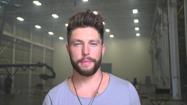 EXCLUSIVE: Chris Lane Helps a Fan With a Real-Life Proposal in His New Music Video -- Go Behind the Scenes of the Romantic Moment!