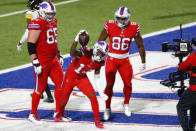 Buffalo Bills wide receiver Stefon Diggs (14) celebrates after scoring on an 18-yard pass play with Pittsburgh Steelers cornerback Steven Nelson (22) defending during the second half of an NFL football game in Orchard Park, N.Y., Sunday, Dec. 13, 2020. (AP Photo/Adrian Kraus)