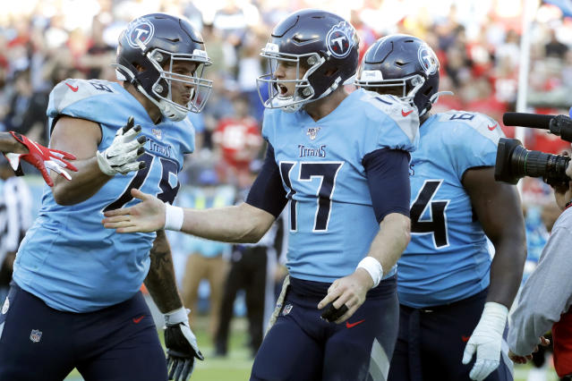 Tennessee Titans quarterback Ryan Tannehill (17) celebrates with offensive tackle Jack Conklin (78) after Tannehill scored a 2-point conversion against the Kansas City Chiefs in the second half of an NFL football game Sunday, Nov. 10, 2019, in Nashville, Tenn. The Titans won 35-32. (AP Photo/James Kenney)