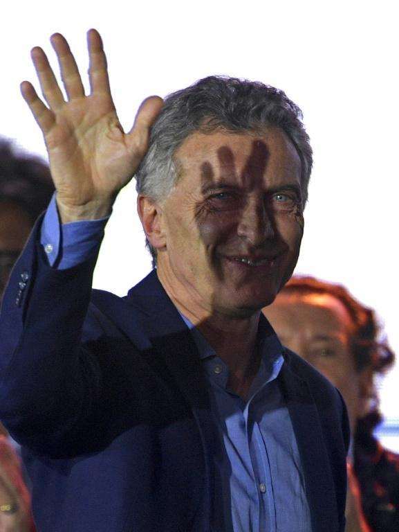 Argentina's President Mauricio Macri waves to supporters after conceding victory to Peronist candidate Alberto Fernandez in presidential elections (AFP Photo/JUAN MABROMATA)