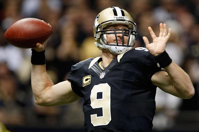 NEW ORLEANS, LA - DECEMBER 30: Drew Brees #9 of the New Orleans Saints throws a pass against the Carolina Panthers at the Mercedes-Benz Superdome on December 30, 2012 in New Orleans, Louisiana. (Photo by Chris Graythen/Getty Images)