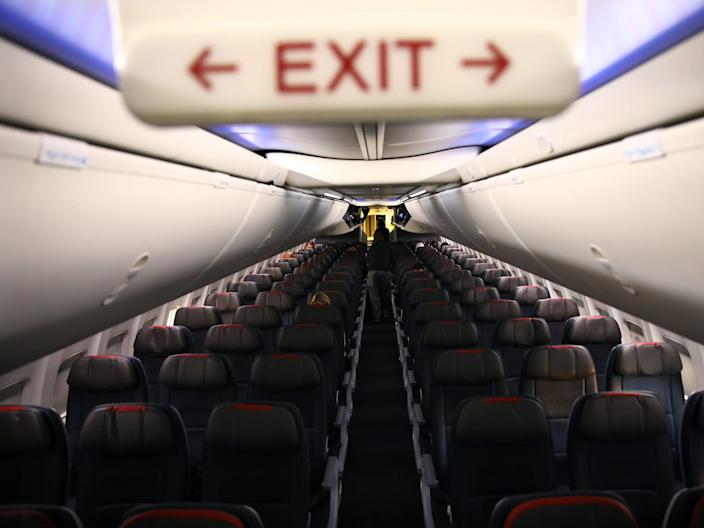 Rows of empty seats of an American Airline flight are seen, as coronavirus disease (COVID-19) disruption continues across the global industry, during a flight between Washington D.C. and Miami, in Washington, U.S., March 18, 2020.