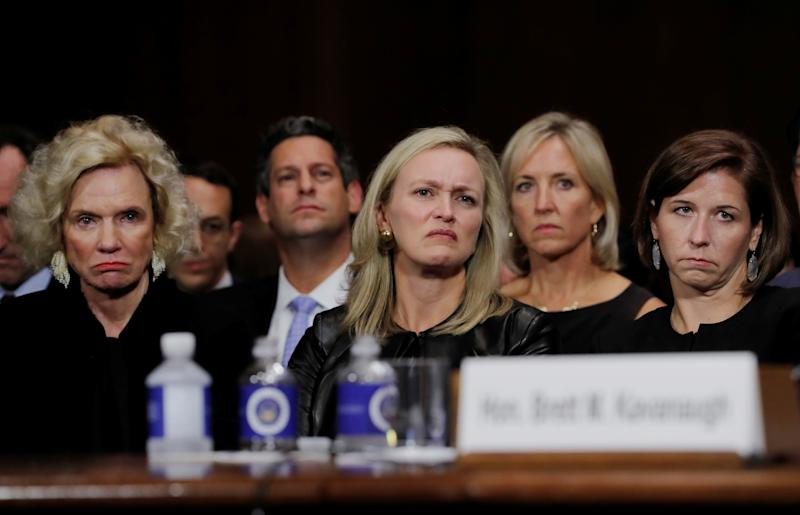 Family members, friends and supporters of U.S. Supreme Court nominee Brett Kavanaugh, including his mother Martha (L), Facebook's Vice President of Public Policy Joel Kaplan (3rd from L), friend Laura Cox Kaplan (C) and his wife Ashley (R) listen to him testify before a Senate Judiciary Committee confirmation hearing on Capitol Hill in Washington, U.S., September 27, 2018. REUTERS/Jim Bourg