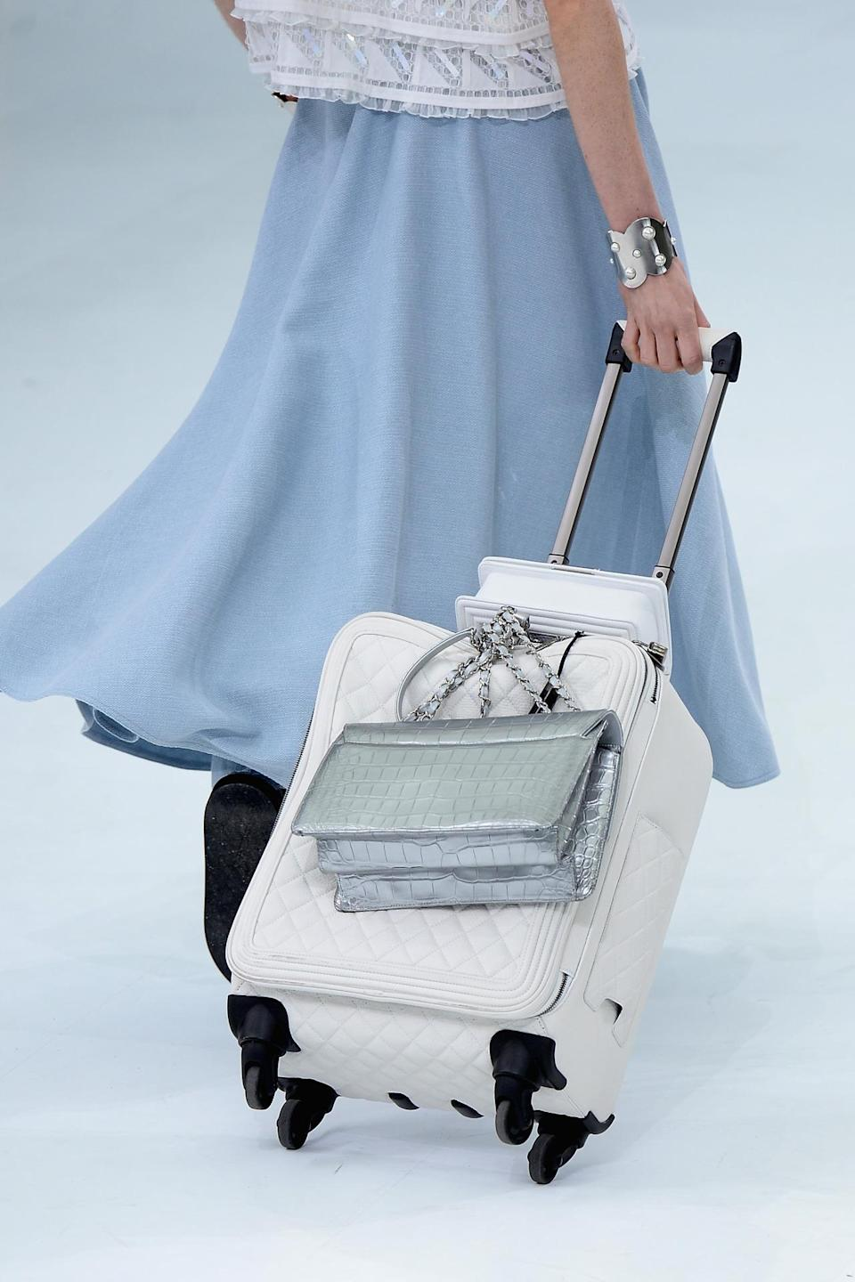 <p>White leather and silver croc might be the world's most luxurious, least practical travel accessories ever made — but they sure are beautiful! <i>(Photo: Getty Images)</i></p>