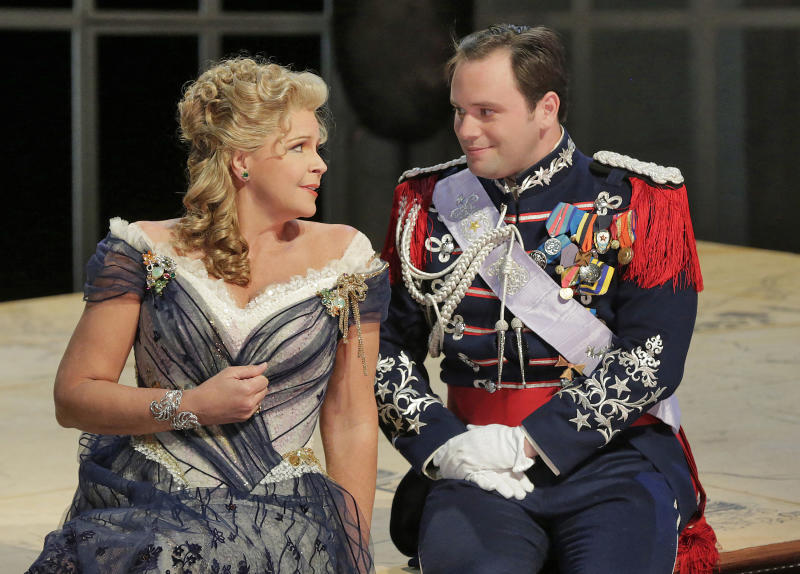 "This June 2013 photo provided by the The Santa Fe Opera shows Susan Graham with Paul Appleby, as Fritz, during a rehearsal of an Offenbach comedy, ""The Grand Duchess of Gerolstein,"" at the Santa Fe Opera in Santa Fe, N.M. (AP Photo/The Santa Fe Opera, Ken Howard)"