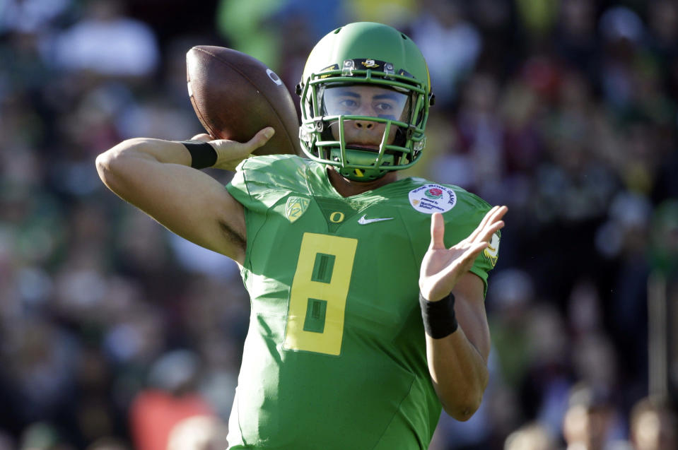 Oregon quarterback Marcus Mariota prepares to throw against Florida State during the first half of the Rose Bowl NCAA college football playoff semifinal, Thursday, Jan. 1, 2015, in Pasadena, Calif. (AP Photo/Jae C. Hong)