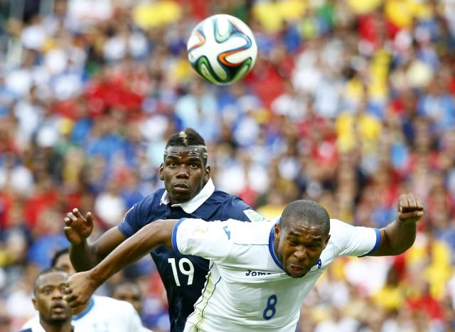 France's Paul Pogba and Wilson Palacios of Honduras fight for the ball during their 2014 World Cup Group E soccer match at the Beira-Rio stadium in Porto Alegre June 15, 2014. REUTERS/Murad Sezer (BRAZIL - Tags: SOCCER SPORT WORLD CUP)