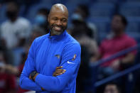 Orlando Magic coach Jamahl Mosley smiles from the bench during the first half of the team's NBA basketball preseason game against the New Orleans Pelicans in New Orleans, Wednesday, Oct. 6, 2021. (AP Photo/Gerald Herbert)