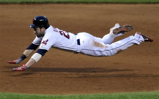 Cleveland Indians' Jason Kipnis slides into third base with a triple in the fourth inning of a baseball game against the Minnesota Twins, Saturday, June 22, 2013, in Cleveland. (AP Photo/David Richard)