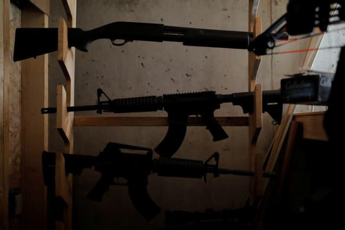 A weapons cache in the basement of a survival camp