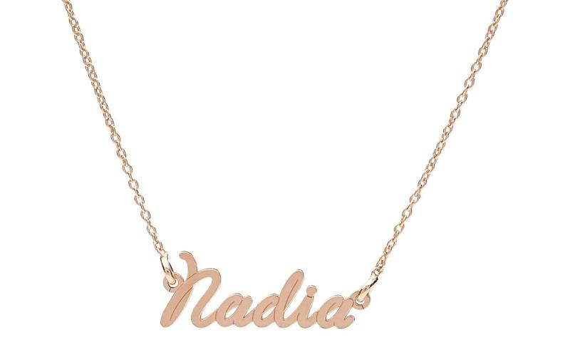 "Get it <a href=""https://www.groupon.com/deals/n-jewell-s-house-small-wire-style-name-necklace"" target=""_blank"">here</a>."