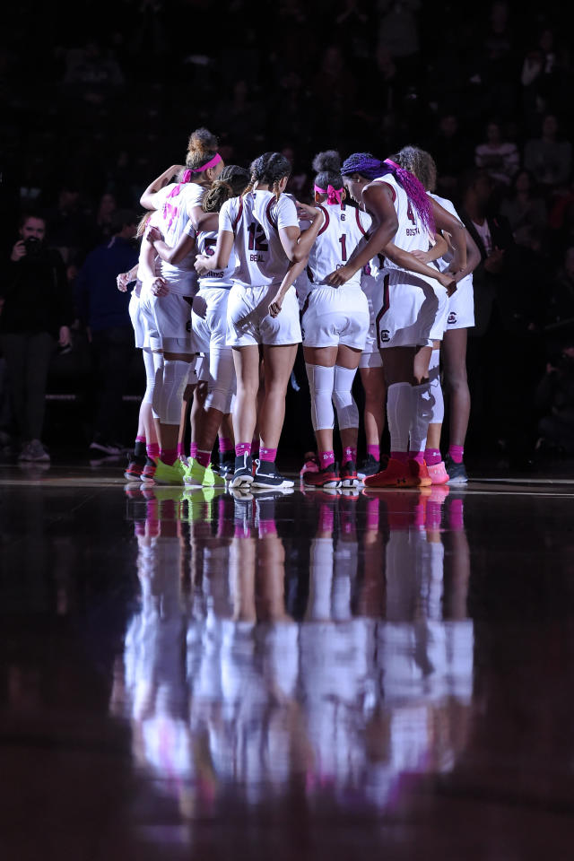 South Carolina players gather before an NCAA college basketball game against LSU, Thursday, Feb. 20, 2020, in Columbia, S.C. (AP Photo/Richard Shiro)