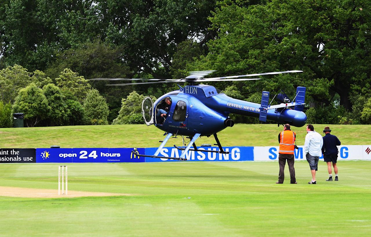 DUNEDIN, NEW ZEALAND - DECEMBER 13: A helicopter is used to try the field before day three of the First Test match between New Zealand and the West Indies at the University Oval on December 13, 2008 in Dunedin, New Zealand.  (Photo by Phil Walter/Getty Images)
