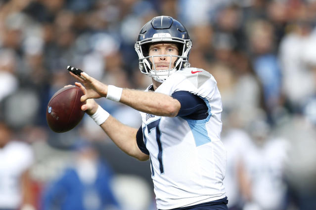 Tennessee Titans quarterback Ryan Tannehill (17) passes against the Oakland Raiders during the first half of an NFL football game in Oakland, Calif., Sunday, Dec. 8, 2019. (AP Photo/D. Ross Cameron)