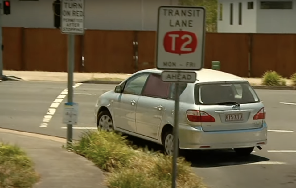 A car is pictured turning left at a red light in Brisbane.