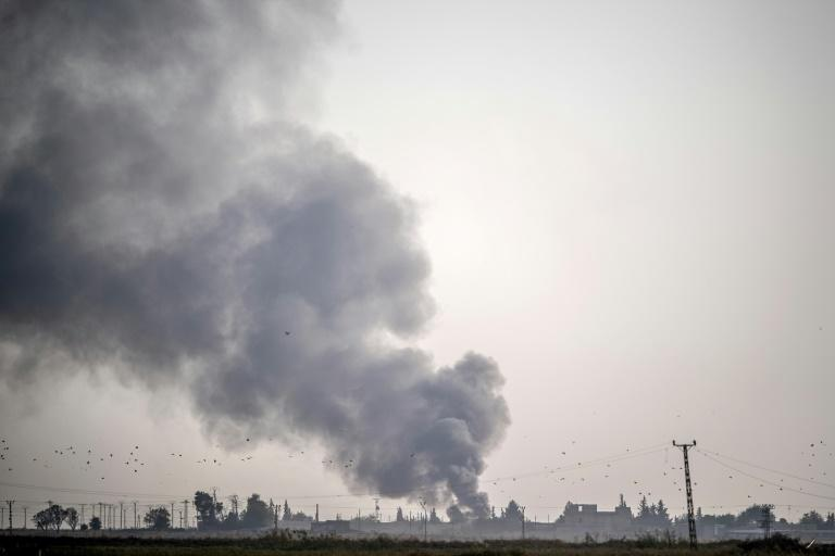 Smoke rises from the Syrian town of Tal Abyad after Turkish bombings