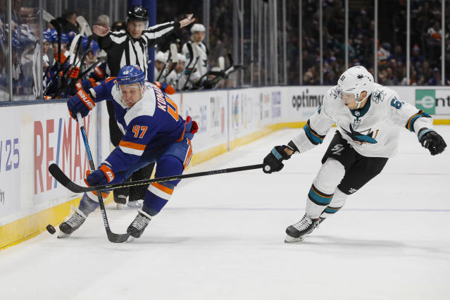 New York Islanders right wing Leo Komarov (47) and San Jose Sharks defenseman Radim Simek, right, battle for the puck during the second period of an NHL hockey game, Sunday, Feb. 23, 2020, in Uniondale, N.Y. (AP Photo/John Minchillo)