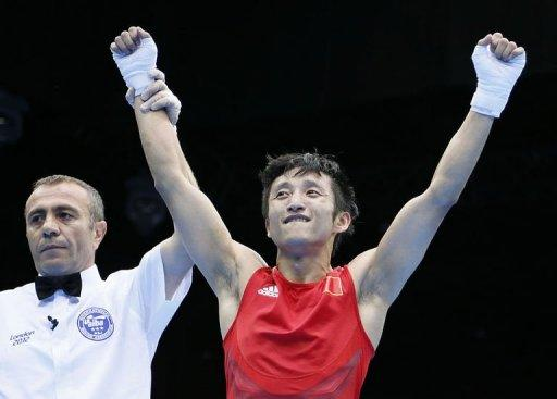 Zou Shiming celebrates his victory