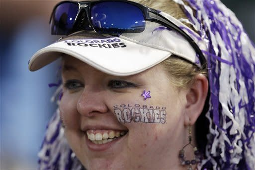 Jennifer Grayson, of Colorado Springs, Colo., smiles as she waits for autographs from Colorado Rockies players before the Rockies' spring training baseball game against the San Francisco Giants on Thursday, March 22, 2012, in Scottsdale, Ariz. (AP Photo/Marcio Jose Sanchez)