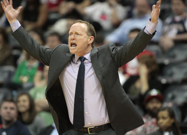 Atlanta Hawks head coach Mike Budenholzer argues a call with a referee in the first half of an NBA basketball game against the Philadelphia 76ers Monday, March 31, 2014, in Atlanta. (AP Photo/Jason Getz)