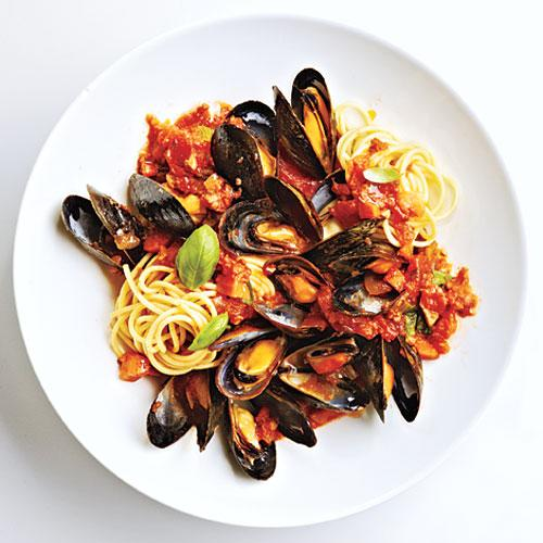 """You will love Mussels Marinara thanks to the slow-cooked red sauce. The red wine and basil make the sauce ultra luxurious – the perfect thing to accompany delicate mussels. Serve over pasta, with a glass of vino rosso (red wine) for a lush and tasty meal.<p><p><a rel=""""nofollow"""" href=""""http://www.myrecipes.com/recipe/mussels-marinara"""">View Recipe: Mussels Marinara</a></p>"""