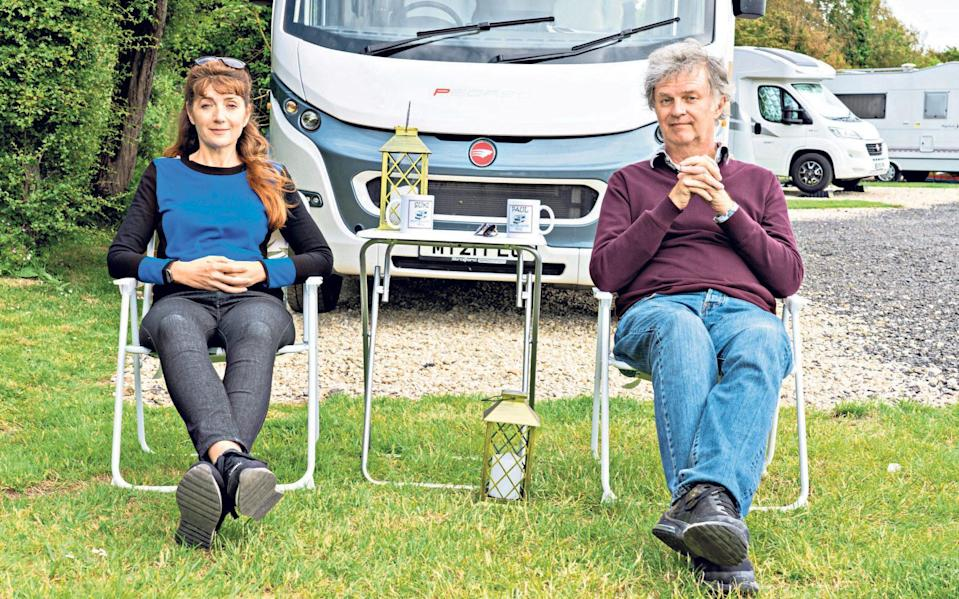 Paul Merton and his wife, Suki Webster, enjoy a cuppa in front of their motorhome - Emily Barker / Curve Media