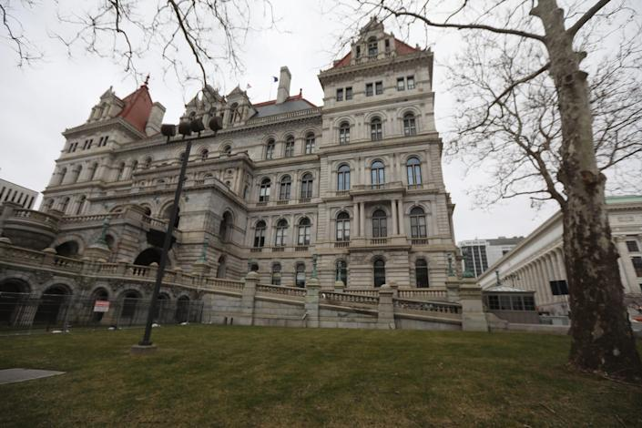 Lawmakers at the New York state Capitol protest the governor's attempts to keep a hand in the investigation into allegations against him.