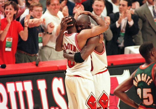 Chicago Bulls star Michael Jordan hugs Randy Brown after beating the Seattle SuperSonics in Game 6 of the 1996 NBA Finals on Sunday, June 16, 1996, in Chicago. The win marked their fourth NBA title. (AP/Michael Conroy)