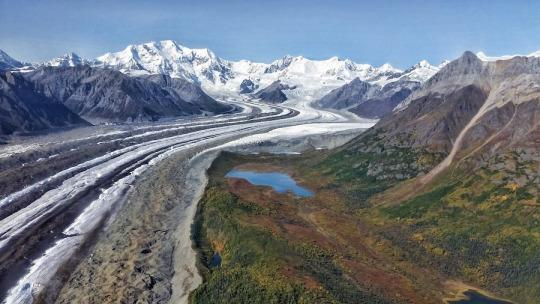"<p>There are only two roads leading into America's largest national park, Wrangell St. Elias National Park in Alaska; and neither road is easily drivable. Most people opt to fly into the park via bush plane and it's worth it with glacier and mountain views like this. It was one of the <a href=""http://www.ottsworld.com/blogs/best-days-on-earth-2015/"" rel=""nofollow noopener"" target=""_blank"" data-ylk=""slk:most spectacular flights I've ever taken in my life"" class=""link rapid-noclick-resp"">most spectacular flights I've ever taken in my life</a>. —Sherry Ott, <a href=""http://www.ottsworld.com/"" rel=""nofollow noopener"" target=""_blank"" data-ylk=""slk:Ott's World"" class=""link rapid-noclick-resp"">Ott's World</a><br></p>"