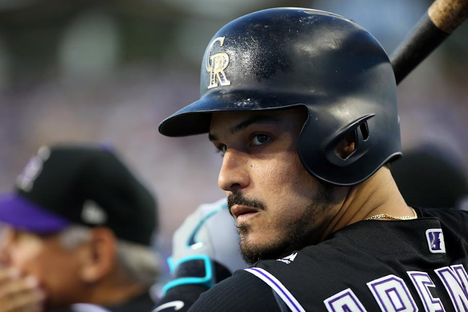 LOS ANGELES, CA - SEPTEMBER 03: Colorado Rockies Third base Nolan Arenado (28) holds a bat in a dugout during a MLB game between the Colorado Rockies and the Los Angeles Dodgers on September 3, 2019 at Dodger Stadium in Los Angeles, CA. (Photo by Kiyoshi Mio/Icon Sportswire via Getty Images)