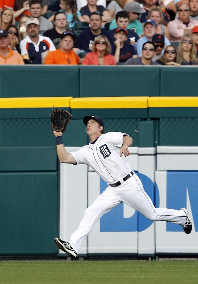 Detroit Tigers left fielder Andy Dirks closes in on a fly ball from Kansas City Royals' Alex Gordon for an out in the third inning during the second game of a doubleheader baseball game, Friday, Aug. 16, 2013, in Detroit. (AP Photo/Duane Burleson)