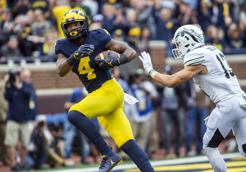 Michigan wide receiver Nico Collins (4) makes a 44-yard touchdown reception as Western Michigan defensive back Harrison Taylor (13) closes in during the second quarter of an NCAA college football game in Ann Arbor, Mich., Saturday, Sept. 8, 2018. (AP Photo/Tony Ding)